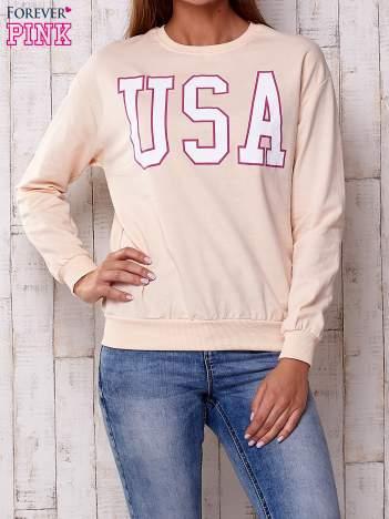 Brzoskwiniowa bluza z napisem USA