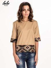 Beżowa bluzka z motywem azteckim