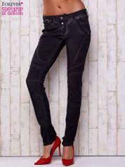Czarne dekatyzowane spodnie z przeszyciami