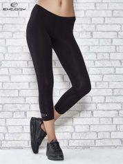 Czarne legginsy sportowe z patką z dżetów na dole