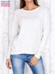 Jasnobeżowy sweter z dłuższym tyłem i zakładką na plecach