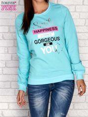 Butik Turkusowa bluza z napisem SMILE HAPPINESS LOOKS GORGEOUS ON YOU