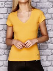 Żółty damski t-shirt sportowy z modelującymi przeszyciami