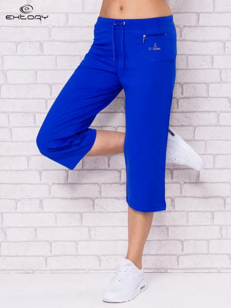 Ciemnoniebieskie spodnie sportowe capri