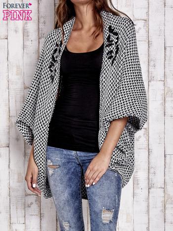 Czarny melanżowy sweter z biżuteryjną aplikacją