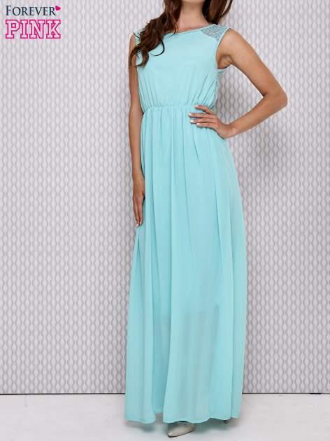 Miętowa sukienka maxi z koronkowym tyłem