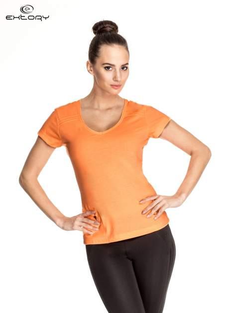 Pomarańczowy damski t-shirt sportowy z kieszonką