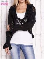 Czarny sweter o szerokim splocie z wiązaniem
