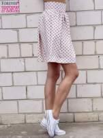 Jasnoróżowa spódnica w grochy z plisami