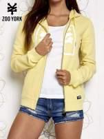 Żółta bluza na suwak z kapturem