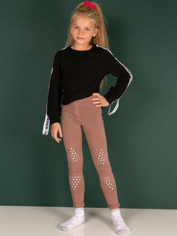Bawełniane beżowe legginsy dziewczęce z wycięciami