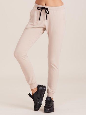 Bawełniane spodnie dresowe beżowe