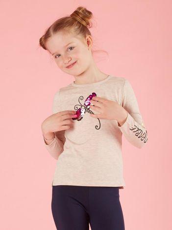 Beżowa bluzka dla dziewczynki z cekinowym motylem