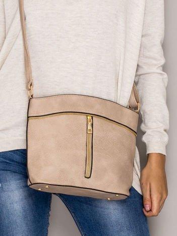 Beżowa torebka ze złotymi suwakami