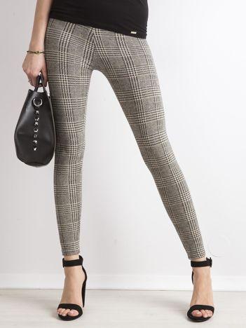 Beżowe legginsy w kratę