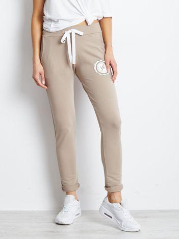 Beżowe spodnie dresowe bawełniane