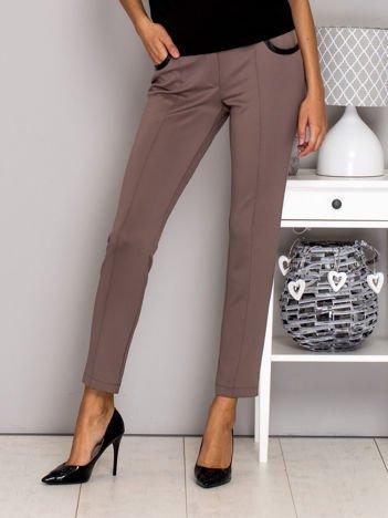 Beżowe spodnie w kant ze skórzanymi wstawkami