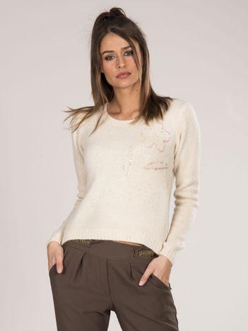 Beżowy sweter damski z cekinami