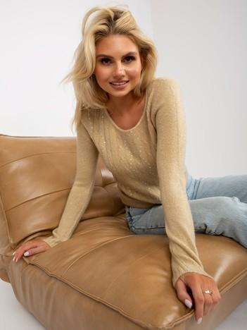 Beżowy sweter w warkocze z cekinami