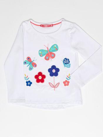 Biała bluzka dla dziewczynki z kolorowymi naszywkami