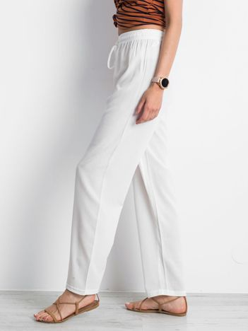 Białe spodnie Inability