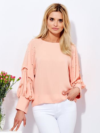 Bluzka brzoskwiniowa z drapowanymi rękawami i perełkami