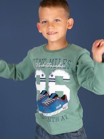 Bluzka dziecięca z bawełną i sportowym nadrukiem zielona