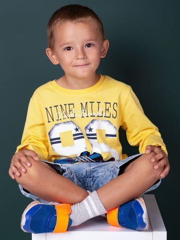 Bluzka dziecięca z bawełną i sportowym nadrukiem żółta