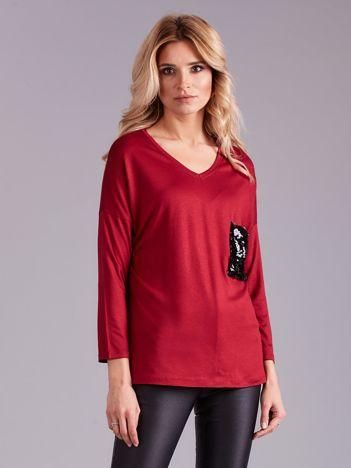 Bordowa bluzka z cekinową kieszenią