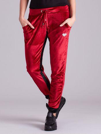 Bordowe welurowe spodnie dresowe