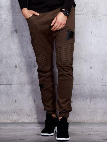 Brązowe spodnie joggery męskie z przeszyciami i łatami