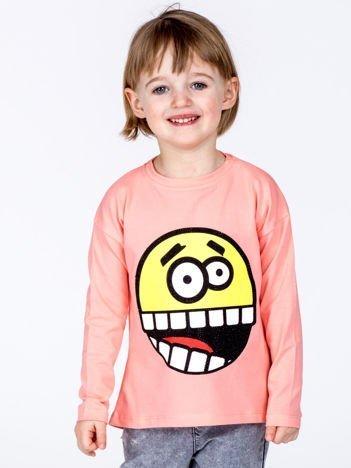 Brzoskwiniowa bawełniana bluzka dziecięca z zabawną emotikonką