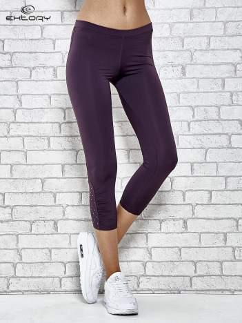 Ciemnofioletowe legginsy sportowe z dżetami na dole nogawki