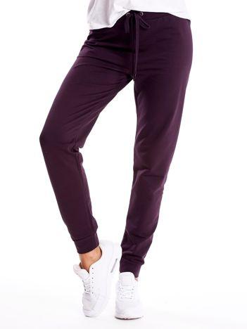 Ciemnofioletowe spodnie dresowe z troczkami