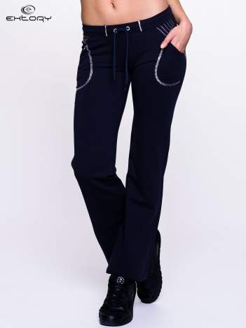 Ciemnogranatowe spodnie dresowe z siateczką