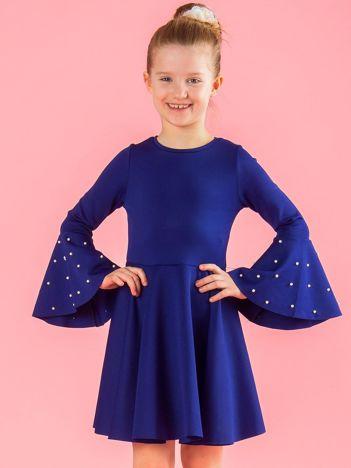 Ciemnoniebieska rozkloszowana sukienka dziewczęca