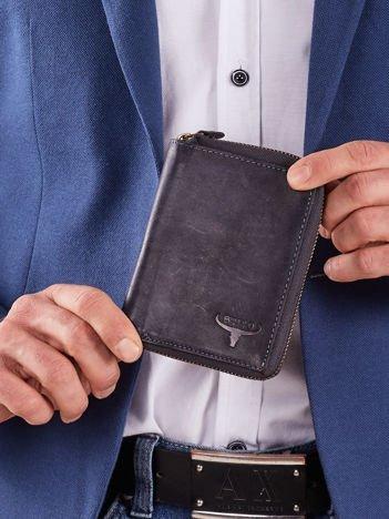Ciemnoniebieski pionowy portfel męski na suwak