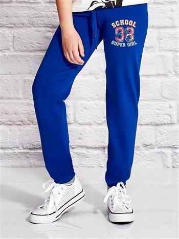 Ciemnoniebieskie spodnie dresowe dla dziewczynki SUPER GIRL