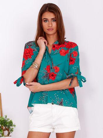 Ciemnozielona bluzka w kwiaty z guzikami i wiązaniami