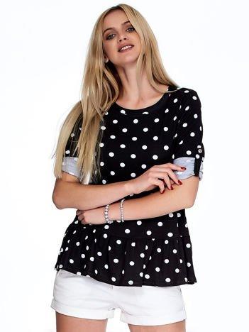 Czarna bluzka w grochy z podwijanymi rękawami