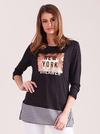 Czarna bluzka w groszki z koszulą i aplikacją