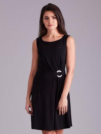 Czarna drapowana elegancka sukienka