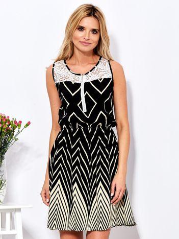 Czarna sukienka w kontrastowe zygzaki