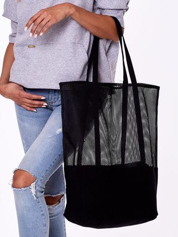 Czarna torba z ażurową górą