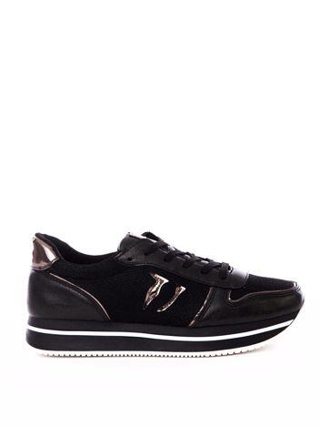 Czarne buty sportowe z ażurową cholewką i perłową poświatą
