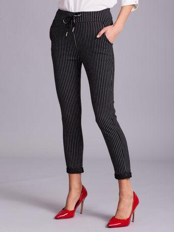 Czarne damskie spodnie w paski