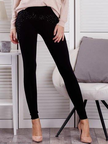 Czarne legginsy push up z koronkową wstawką i dżetami