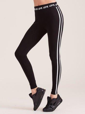 Czarne legginsy z białymi lampasami