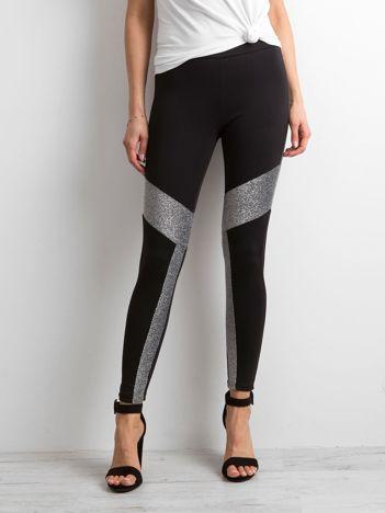 Czarne legginsy z metalicznymi wstawkami