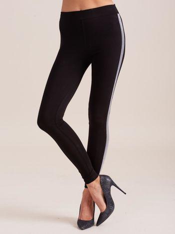 Czarne legginsy ze srebrnymi lampasami